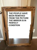 Large antique ornate gold and black wood framed mirror in Cleveland, Texas