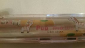Brand new resin chopsticks in a carrying case from the San Diego park in Oceanside, California