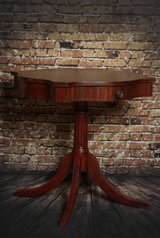 Refinished mahogany drum table in Schaumburg, Illinois