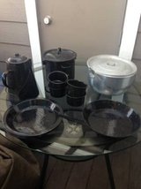 Camping silver and speckled black cookware plates cups coffee pot in Travis AFB, California