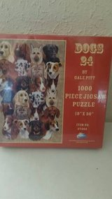 "Sealed 1000 piece puzzle by Gale Pitt titled ""Dogs 24"" in Camp Pendleton, California"