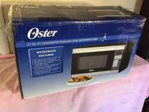 Oster  stainless steel microwave brand new in box! in Travis AFB, California