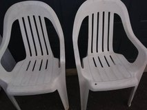 2 white plastic lawn chairs in Travis AFB, California