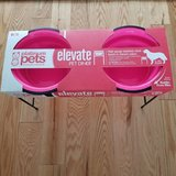 platinum pets neon pink double diner feeder with stainless steel dog bowls. in Lockport, Illinois