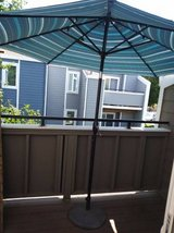 Out door umbrella with heavy duty cast iron stand in Travis AFB, California