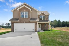 COZY UP in this OPEN CONCEPT LR w/Stone Fireplace in Fort Campbell, Kentucky