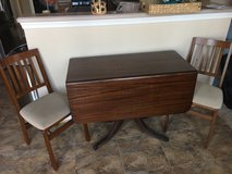 Antique drop leaf dining table and two folding chairs in Fairfax, Virginia
