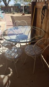Vintage thick glass top patio set in Yucca Valley, California