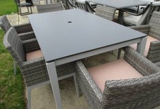 Outdoor Dining Table with 6 Wicker Style Chairs in Elgin, Illinois
