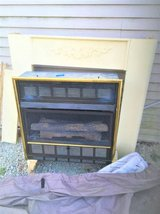 gas wall fireplace (mantle as shown in photo included) in Naperville, Illinois