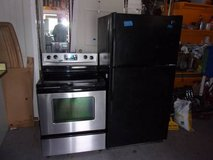Kenmore Black Refrigerator and Whirlpool Black Glass Top Stove Set in Fort Riley, Kansas