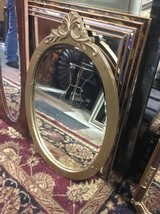 Oval Mirror with Burnished Gold Colored Frame in Tacoma, Washington