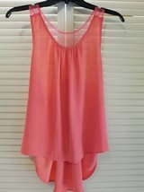 Coral colored razor backed beaded sheer top in Camp Pendleton, California
