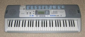 Casio LK-100 Key Lighting System Electronic Midi Keyboard Piano 61-Key in Oswego, Illinois