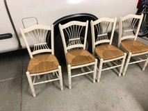 Set of 4 solid wood and sea grass dining chairs in Travis AFB, California