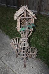 Nice Outdoor Two Plant Planter Made of Tree Cuttings in Spring, Texas