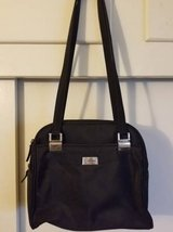 Black purse with multiple zippered sections by Unlisted in Camp Pendleton, California