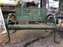 Old rustic green bench in Bartlett, Illinois