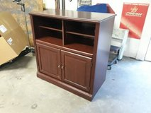 TV Stand with shelving and storage drawer in The Woodlands, Texas
