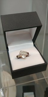 sterling silver bypass fashion ring accented with 4 rows of cubic zirconia size7 in Camp Lejeune, North Carolina